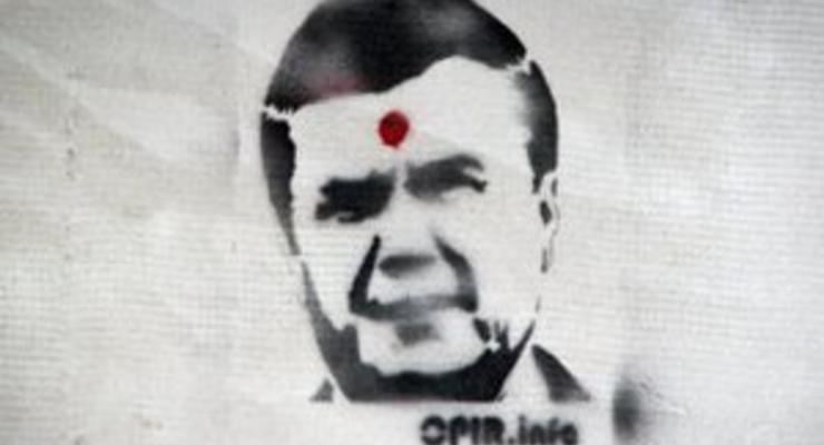 Во Львове на стенах появились изображения Януковича с простреленной головой