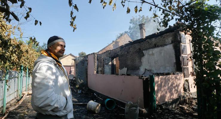 Уничтоженные дома, разбитые авто и военный патруль: фото Калиновки после ночи ада